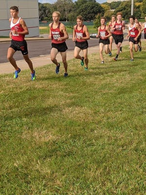 Metamora's Colton Barb, left, is followed closely by Pekin runners Noah Sivori, Jonny Blanchard, Huston Gillespie, Jackson Custer and Lucas Glesne. Running with the Pekin pack is Metamora's Nathan Haines.