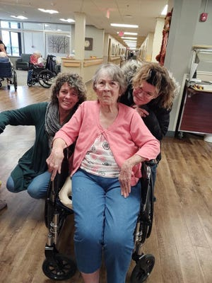 Vera Huffman, center, pauses for a photo with daughters Rhonda Daum, left, and Jo Parker as they mark Thanksgiving 2019 at Heritage Health Therapy & Senior Care in Chillicothe. Huffman, 81, died there in the COVID-19 wing Oct. 26.