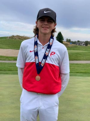 Mason Minkel of Pekin shows off the medal he received for finishing in ninth place in the individual standings at the Class 3A boys golf state tournament at The Den at Fox Creek Golf Course in Bloomington in 2019.