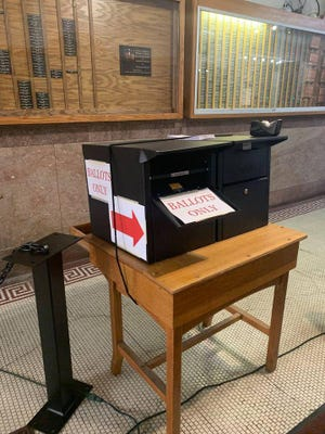 """Logan County Clerk's office has installed a drop box right inside the courthouse. """"We are hoping this will provide an option for those who would rather not mail back their ballot to our office. You do not need to go through security. You can simply walk through the doors and drop off your ballot there,"""" wrote Theresa Moore."""