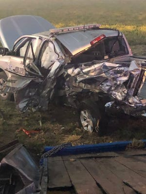 An image posted to the Phillips County Sheriff's Office Facebook page shows damage to a deputy's patrol vehicle after a semi struck its rear, pushing the patrol vehicle into a ditch on K-383 highway.