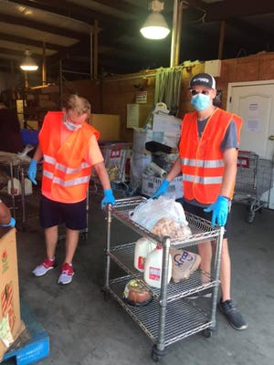 Volunteers at a recent drive-thru food give-away in Rincon.