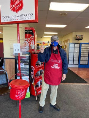 Jim Conboy was among the many people who helped ring the bell and bring in donations during the Red Kettle Campaign for the Cheboygan Salvation Army this year. Photo by Diane Raab