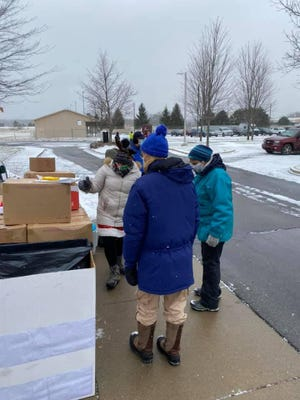United Way Montcalm -- Ionia Counties distributed food and hygine boxes to Montcalm County residents Christmas Eve at the Montcalm Community College Greenville Campus. United Way will distributed boxes to Ionia County residents Tuesday, Dec. 29, at Ionia High School.
