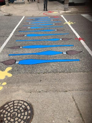"""This repainting of the downtown crosswalks was during the annual """"Repaint the Pavement"""" activity sponsored by Sherwin Williams on Sunday."""