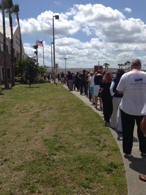 Parents lined up about 12:10 p.m. outside Melbourne High to pick up students after a bomb threat triggered an evacuation.