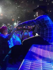 Garth Brooks meets with Teresa Shaw during his Nov. 7, 2014, concert at the Target Center in Minneapolis. The country singer stopped his show when he realized that the mother of three from Iowa was battling cancer.