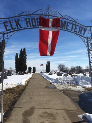 The Danish flag hangs at the entrance to the Elk Horn cemetery on the day of Egon Simonsen's funeral.