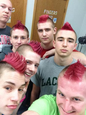 Laconia wrestlers got pink mohawk haircuts to show their support for a teammate's sister who is battling cancer.