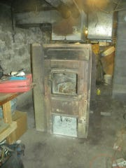 This old wood-burning furnace was no longer heating the Rhoades' home properly.