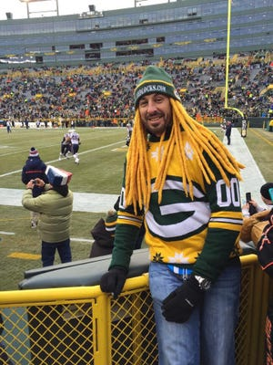 Thomas Gryniewicz has become instantly recognizable at Lambeau Field with his Chedlocks.