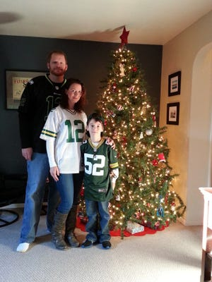 Angelee Bailey poses with son Avory and husband Grant. Grant is a longtime Seattle Seahawks fan, but Angelee married him anyway.
