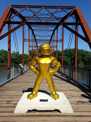 The Golden Herky statue stands on the Sutliff Bridge on Monday, July 7, 2014.