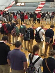 Students at Lawrence County High School gather in prayer for Peyton Flowers