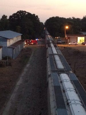 A man and a child were killed and another child transported when they were hit by a train in Hazlehurst this evening.