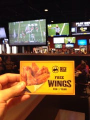 Nathan Criner shows off his free voucher for free wings