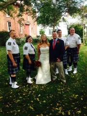 Members of the Gates Keystone Club Pipes and Drums played for the wedding of Caurie Putnam, at center with husband Eric Ferguson. The couple hired all west-side vendors.