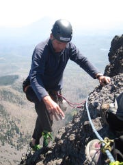 Steve Dougherty ascends Three Fingered Jack, a more technical climb that he led during 2013. Dougherty said his goal for the year was to sign 100 summiting certificates for members of his climb parties. He ended up signing 104.