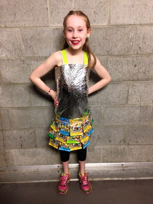 """Cora Sorem models """"Lego Me,"""" a dress made from trash by Carlee Wright. This design and dozens more will be viewable at Upcycle Oregon on Saturday, April 11, at the Oregon State Capitol. Upcycle Oregon is organized by DIY Studio, in collaboration with a number of community partners."""