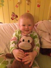 "Elizabeth ""Effy"" Watson, 3, cuddles with Nunny, her stuffed monkey. Effy has had Nunny since she was a baby, says Jennifer Watson, her mother."