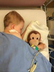"Elizabeth ""Effy"" Watson, 3, naps at the hospital with her stuffed monkey, Nunny."