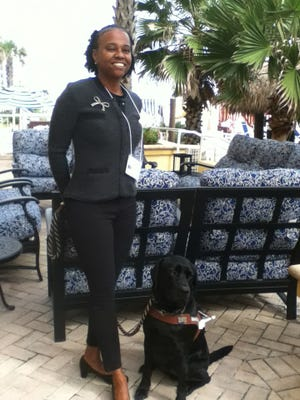 Tiffany Baylor and her guide dog, 2-year-old black lab Lando.