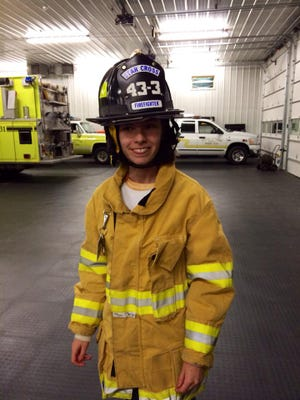 Jenna Toy of Franklin Township was sworn in last week as an honorary firefighter with Star Cross Volunteer Fire Company.