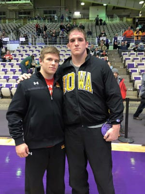 St. Mark's High graduates Josh Snook (left) and and Bobby Telford met as their respective college teams competed against each other Friday. Snook wrestles at 174 for Maryland, and Telford wrestles for top-ranked Iowa.