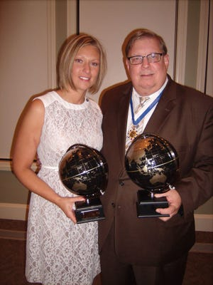 Bridget Tetak, Distinguished Service Award, left, and Rich Lueckel, Kiwanian of the Year