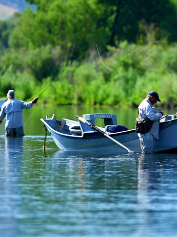 Anglers fly fish the Missouri River just below Craig.