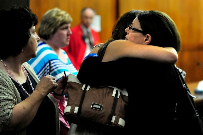 Denise Leuthold's mother Diane Newton gets a hug after the guilty verdict Monday at the Peoria County Courthouse. Newton's son-in-law Nathan Leuthold was convicted of killing her daughter Denise Leuthold on Valentine's Day in 2013.