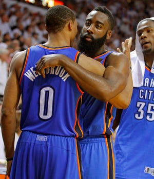 Oklahoma City's James Harden, center, hugs Russell Westbrook, as Kevin Durant watches during the final minutes of Game 5 of the NBA Finals between the Oklahoma City Thunder and the Miami Heat at American Airlines Arena, Thursday, June 21, 2012. Oklahoma City lost 121-106. Photo by Bryan Terry, The Oklahoman
