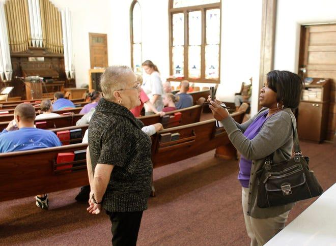 Oklahoman Faith Editor Carla Hinton shoots a video interview of the Rev. Claudia Lovelace before the last service at Skyline Urban Ministries church. [Doug Hoke/The Oklahoman]