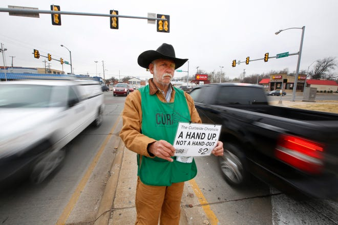 Gary Fields sells the Curbside Chronicle at NW 23 and Broadway in Oklahoma City on Jan. 6, the day before an anti-panhandling ordinance went into effect. [Photo By Steve Gooch, The Oklahoman]
