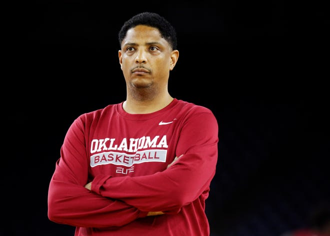 Oklahoma assistant coach Lew Hill watches practice on Final Four Friday before the national semifinal between OU and Villanova in the NCAA Men's Basketball Championship at NRG Stadium in Houston on April 1, 2016. Hill, 56, reportedly died Sunday. [Photo by Nate Billings, The Oklahoman]