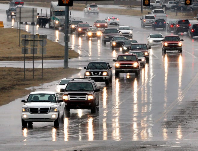 Traffic moves over slick, wet roads on State Highway 9 near I-35 in Norman in 2017. [The Oklahoman archives]