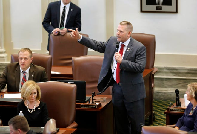 Rep. Kevin McDugle joins the debate on SB 867, addressing long-lateral drilling, with fellow legislators on the House floor Wednesday, May, 24, 2017. Photo by Jim Beckel, The Oklahoman