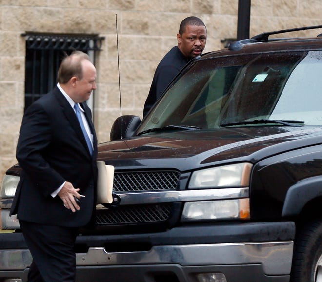 Lamont Evans, suspended Oklahoma State assistant basketball coach, gets into a car after leaving the federal courthouse in Oklahoma City, Wednesday, Sept. 27, 2017. Evans is one of four college coaches charged in a federal investigation focused on fraud and corruption in college basketball. Photo by Nate Billings, The Oklahoman