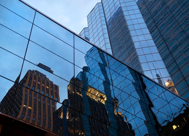 Mirrored windows reflect images of downtown buildings at dusk on Tuesday, April 24, 2018. Photo by Jim Beckel, The Oklahoman