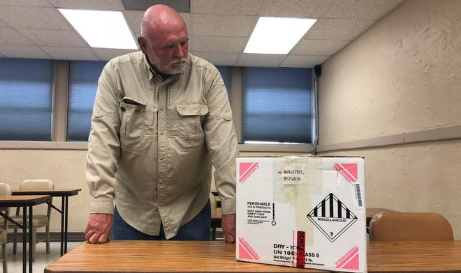 Lt. Don Miller solved the 1987 cold case murder of Susan Woods. He is pictured with a box of evidence from the case inside the Stephenville Police Department.