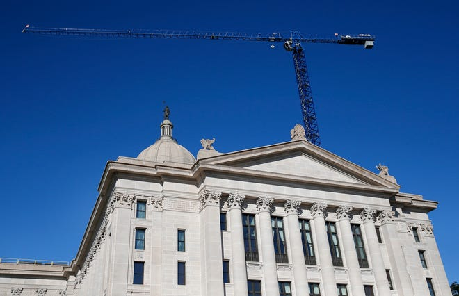 A crane is pictured above the state Capitol in Oklahoma City, Thursday, Oct. 11, 2018. Photo by Sarah Phipps, The Oklahoman