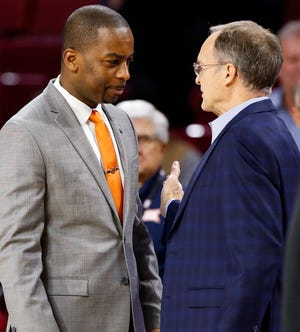 Oklahoma State head coach Mike Boynton, left, and Oklahoma head coach Lon Kruger talk before a Bedlam men's college basketball game between the Oklahoma Sooners (OU) and the Oklahoma State Cowboys (OSU) at the Lloyd Noble Center in Norman, Okla., Saturday, Jan. 5, 2019. Photo by Nate Billings, The Oklahoman