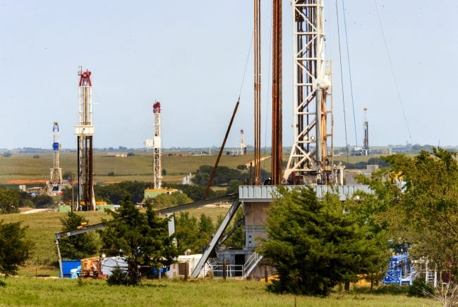 Oklahoma hasn't seen an active drilling rig count of 14 or more since early this year, unlike when this photograph was taken near Chickasha in 2018. [THE OKLAHOMAN ARCHIVES]