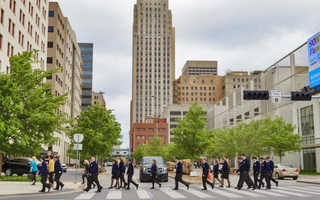 Students from Durant walk through the streets of downtown during a lunch break from the 2018 annual Oklahoma FFA Convention at the Cox Convention Center. The future of the FFA conferencce in Oklahoma City is uncertain following the Cox Center transformation into Prairie Surf Studios. [CHRIS LANDSBERGER/THE OKLAHOMAN]