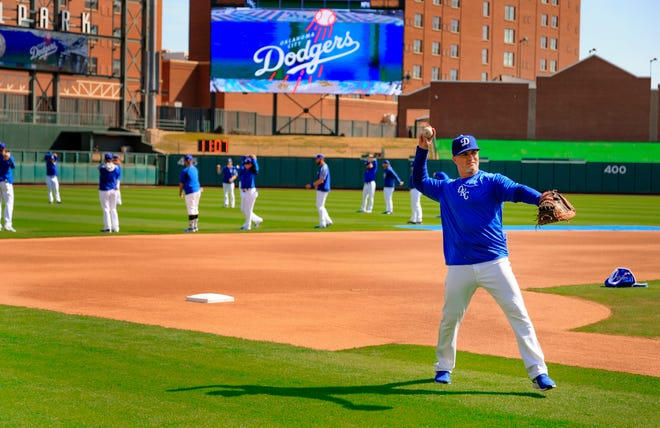 Oklahoma City Dodgers manager Travis Barbary warms up with the team before practice at the Chickasaw Bricktown Ballpark in Oklahoma City, Okla. on Tuesday, April 2, 2019. The Dodgers will open the season on Thursday against San Antonio. Photo by Chris Landsberger, The Oklahoman