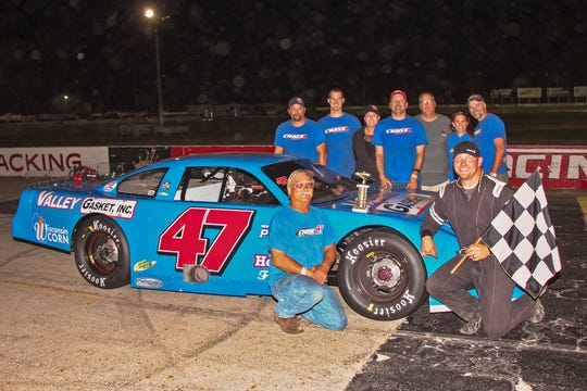 Edgerton's Casey Johnson poses with his Appleton-based Chase Motorsports team after capturing the Fox River Racing Club super late model title at Wisconsin International Raceway in Kaukauna in 2018. Johnson remains one of the Midwest's busiest short track racers with 51 shows on his 2019 schedule.