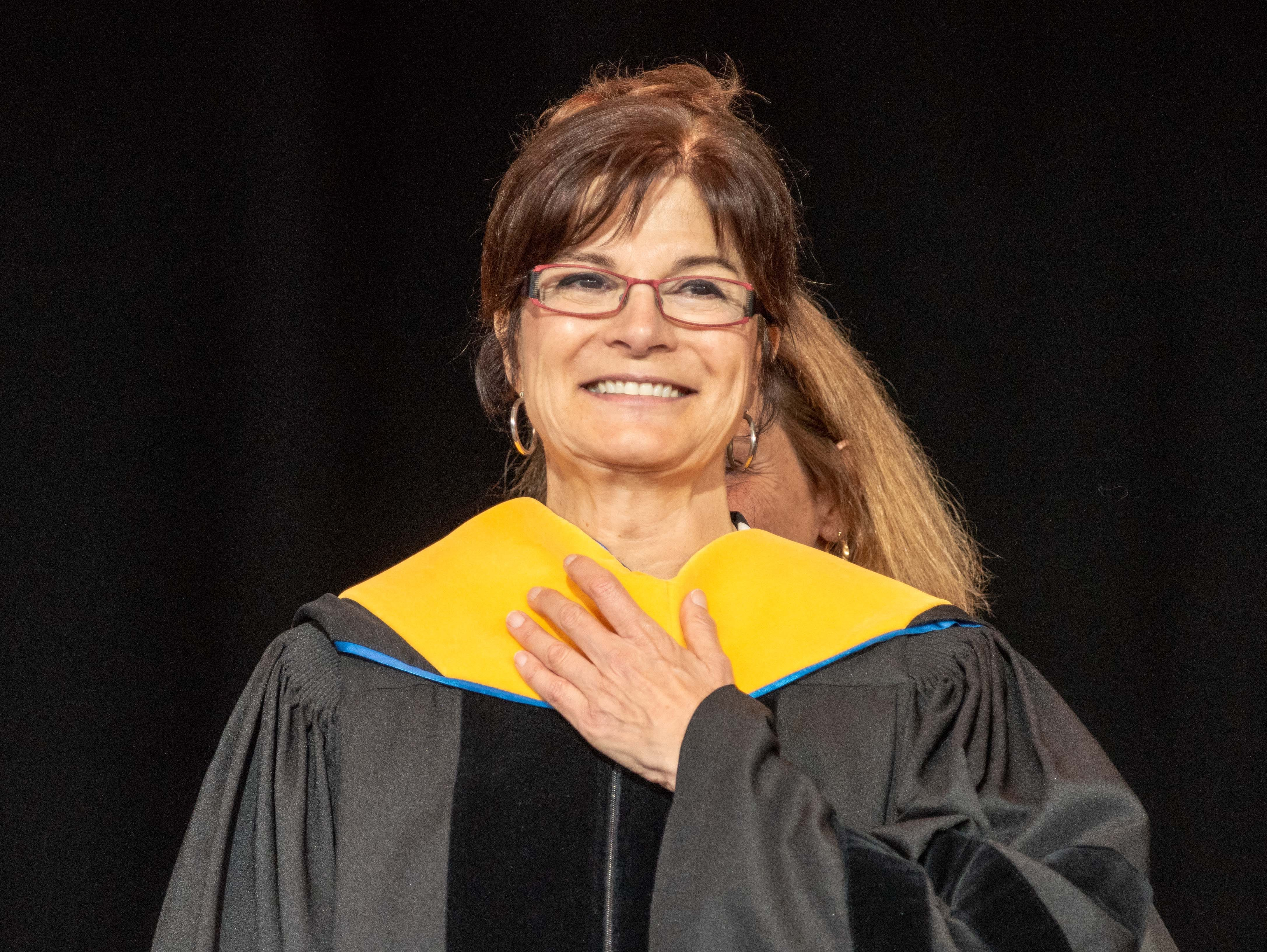 Carolyn Porco, the commencement speaker, received an honorary degree at  the Monmouth University undergraduate commencement for the class of 2019 at PNC Bank Arts Center, Holmdel, on May 15, 2019.