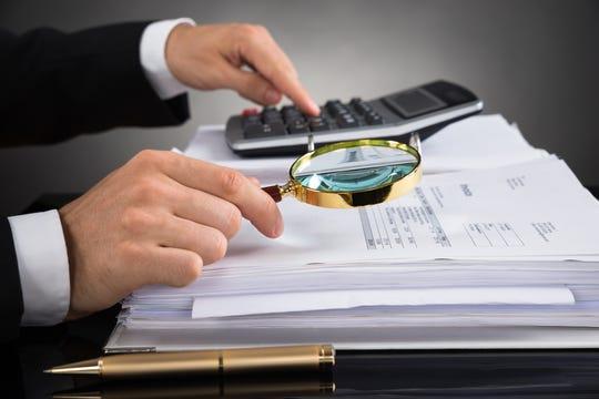 Investigating finances.