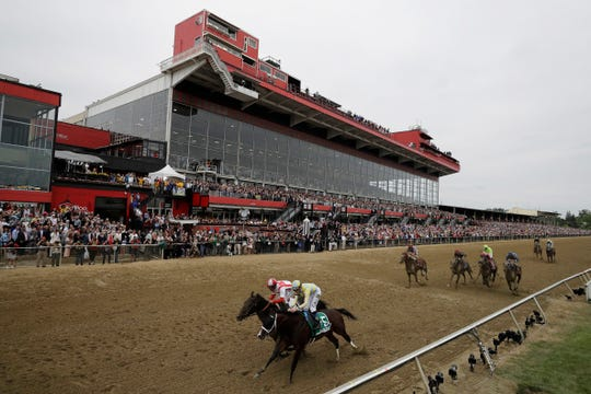 Cloud Computing (2), ridden by Javier Castellano, left, wins 142nd Preakness Stakes horse race at Pimlico race course as Classic Empire (5) with Julien Leparoux aboard takes second, in Baltimore.