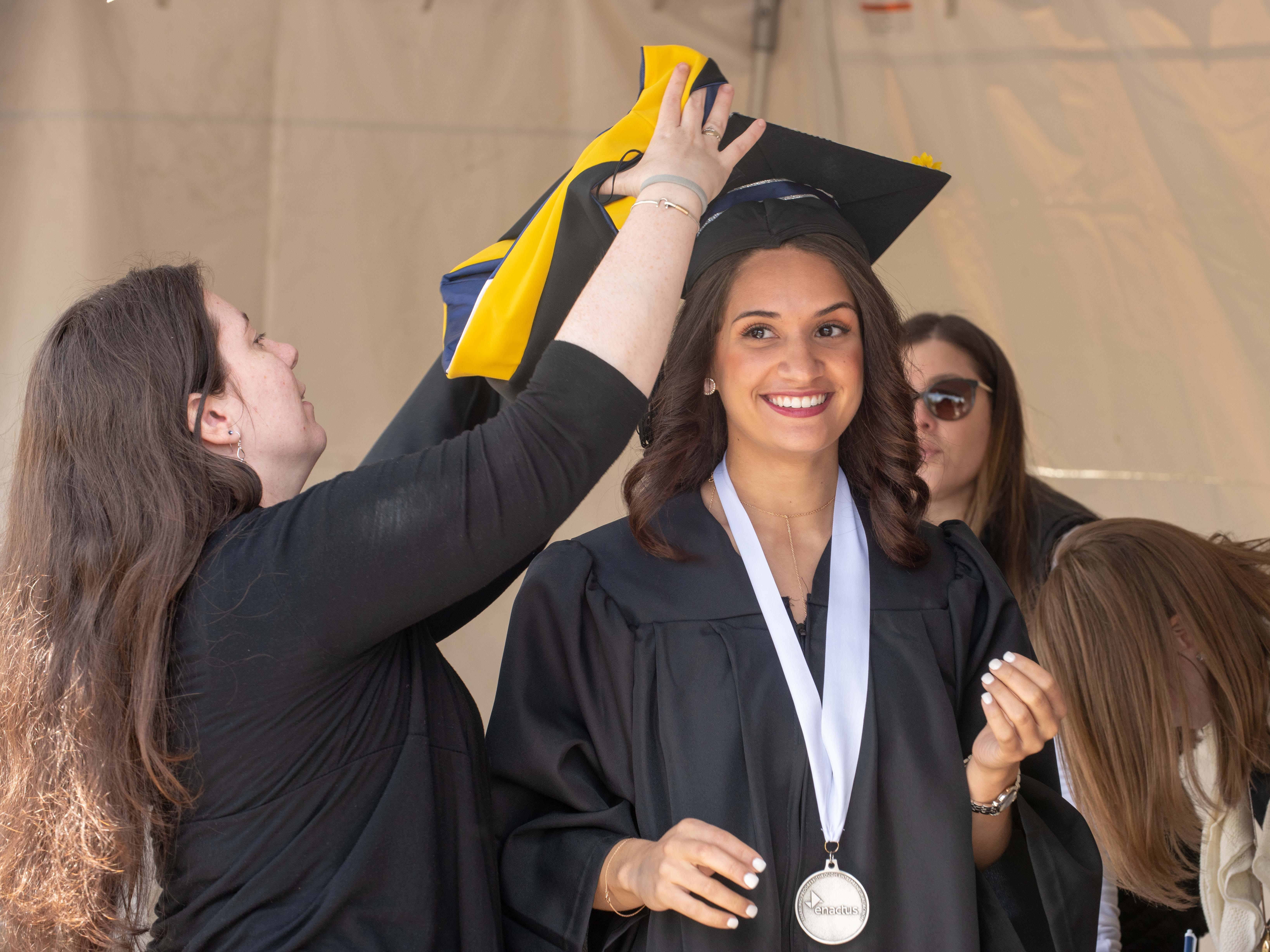 Graduate Diana Pralgo of New York City gets ready for the Monmouth University undergraduate commencement for the class of 2019 at PNC Bank Arts Center, Holmdel, on May 15, 2019.